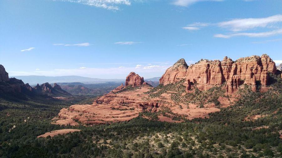 View Of Rocks On Landscape Against Sky