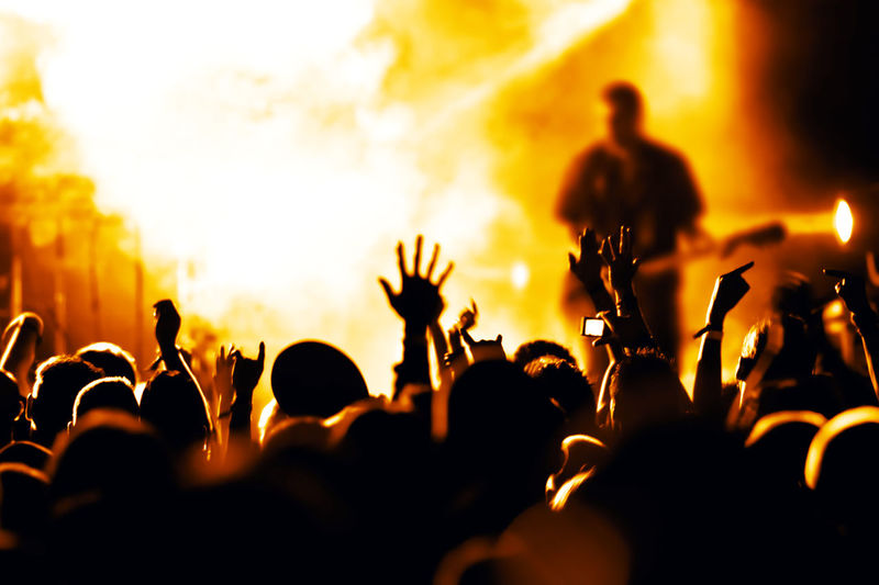 cheering crowd in front of bright stage lights Applauding Band Celebration Cheerful Club Concert Crowd Dance Disco Entertainment Event Festival Happy Human Jam Large Group Of People Light Music Musician Night Nightlife Party Show Sound Stage