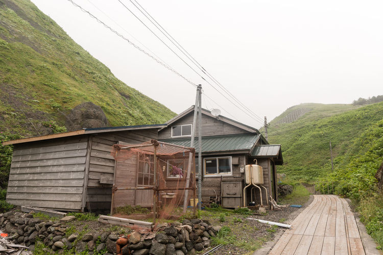 Building Exterior Agriculture House Built Structure Rural Scene Agricultural Building Business Finance And Industry Architecture No People Outdoors Roof Day Industry Mountain Nature Rebun Island Japan Hokkaido