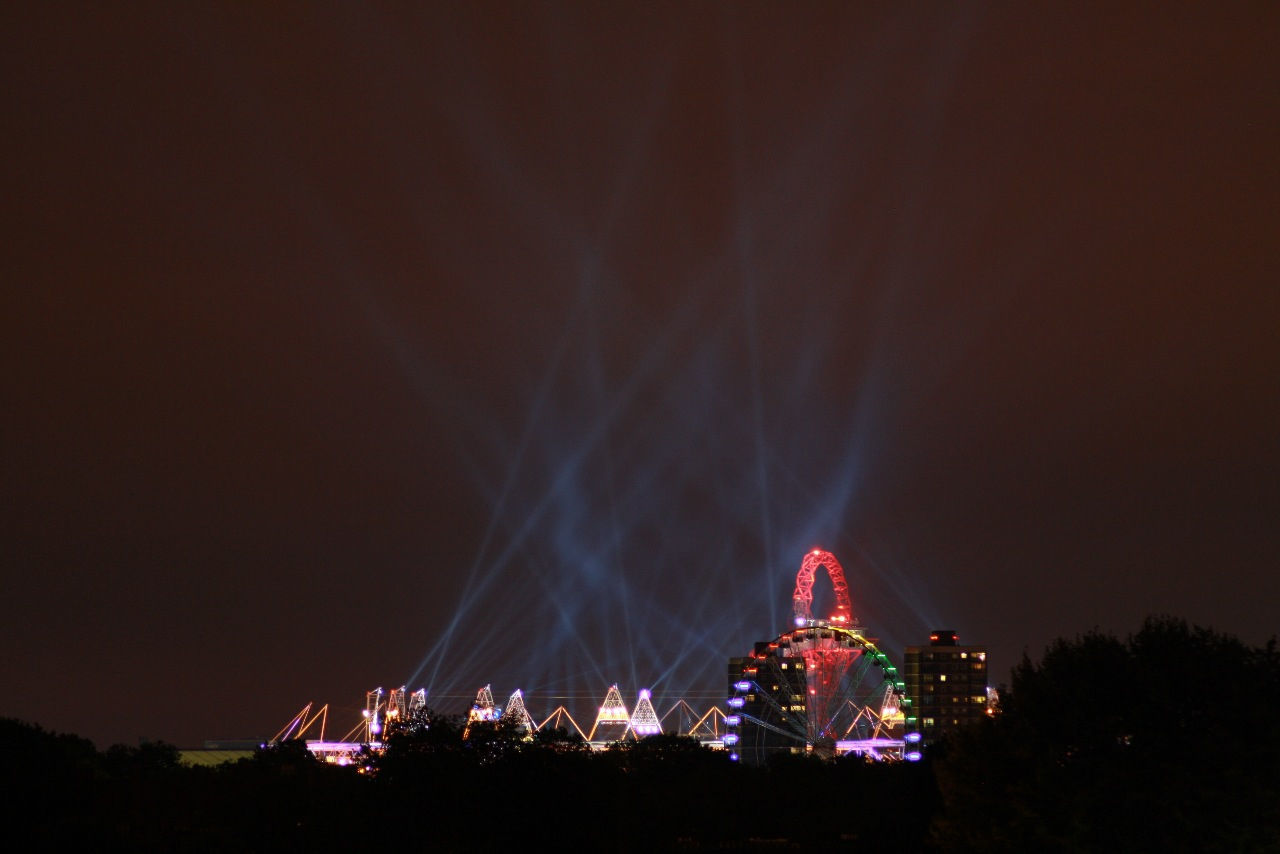 Amusement park ride lit up at night