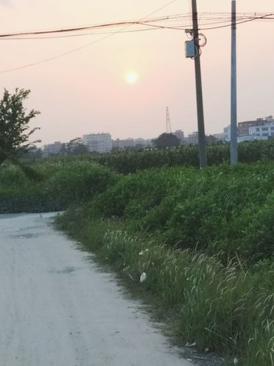The dirt road Chinese Village Setting Sun