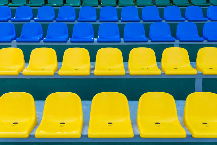 Full frame shot of empty seats in stadium