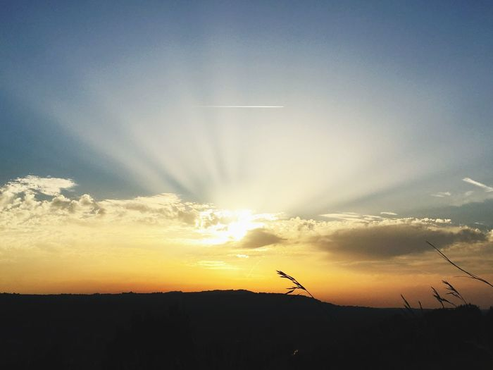 Solctice sunset Journey Sunlight Sunshine Sun Going Down Sun Penetrating Clouds Sunrays Aeroplane In The Sky Sunset Silhouette Nature Beauty In Nature Sky Scenics Tranquil Scene Tranquility Outdoors No People Sun Vapor Trail
