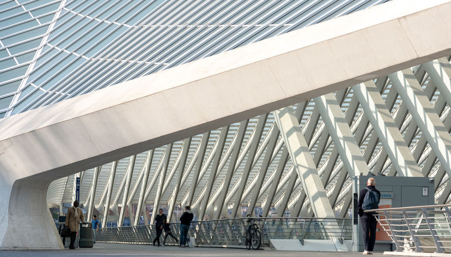 Guillemins station, Liège Guillemins Liège Liège-guillemins Architecture Built Structure Real People Walking Transportation Connection Incidental People Business Person City Modern Architectural Column Outdoors Travel Adult People Architecture Repeating Patterns