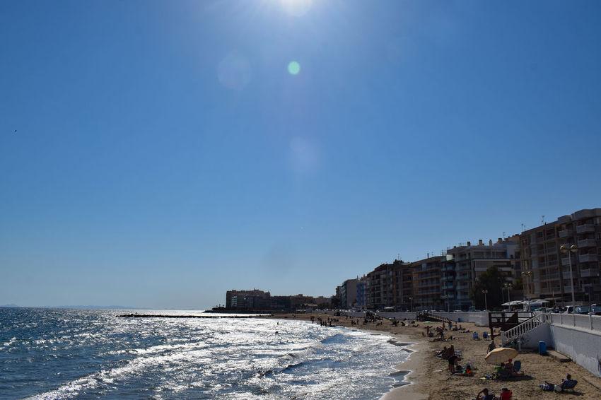 a beach SPAIN Holiday Destination City Beach Sea Sand Clear Sky Sky Architecture Shining Shore Horizon Over Water Sun Seascape Sunbeam Ocean Calm Wave