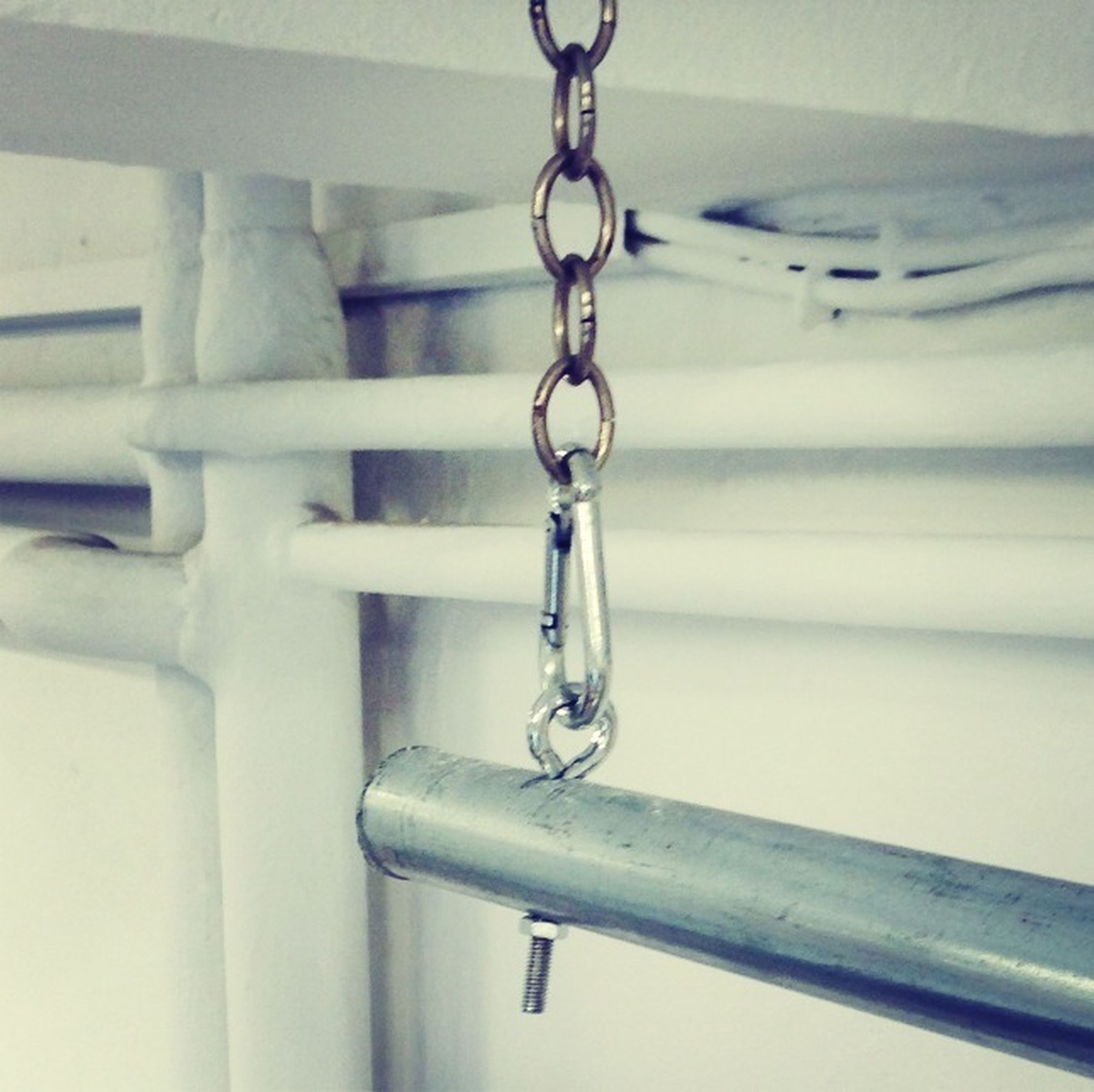 indoors, metal, close-up, metallic, focus on foreground, hanging, still life, no people, security, detail, shiny, safety, protection, part of, pattern, handle, wall - building feature, in a row, day, reflection