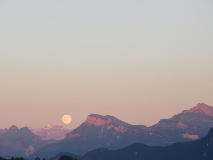 Full moon in sky and mountain