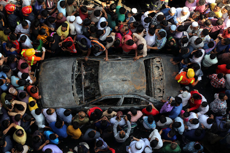 High angle view of group of people and car