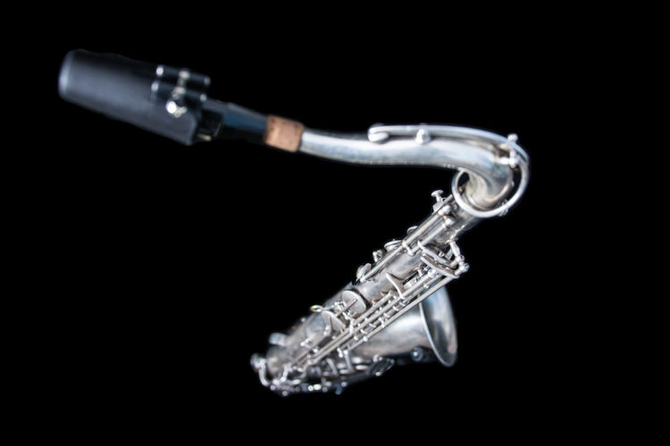 A silver saxophone. Music Sax Arts Culture And Entertainment Black Background Brass Brass Instrument  Cut Out Jazz Music Metal Music Musical Instrument No People Saxophone Shiny Silver Colored Single Object Studio Shot Wind Instrument