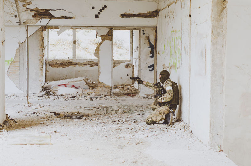 Airsoft Game Architecture Building Abandoned Gun Built Structure Armed Forces Military Day People Real People Indoors  Damaged Government Army Soldier Weapon Security Old Full Length Uniform Ruined Abondoned Buildings