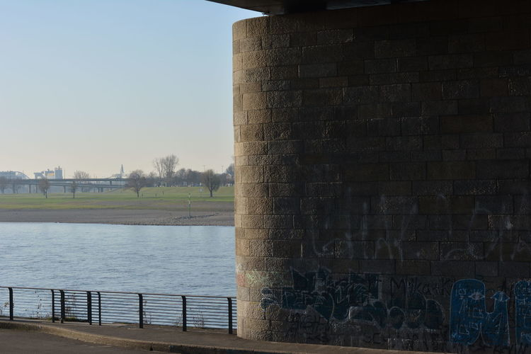 Architecture Day Grafitti Nature No People Outdoors River River View Sky Street Art Tags Wall Wall Art Water Riverside Riverbank Riverside View Rhein Contrast