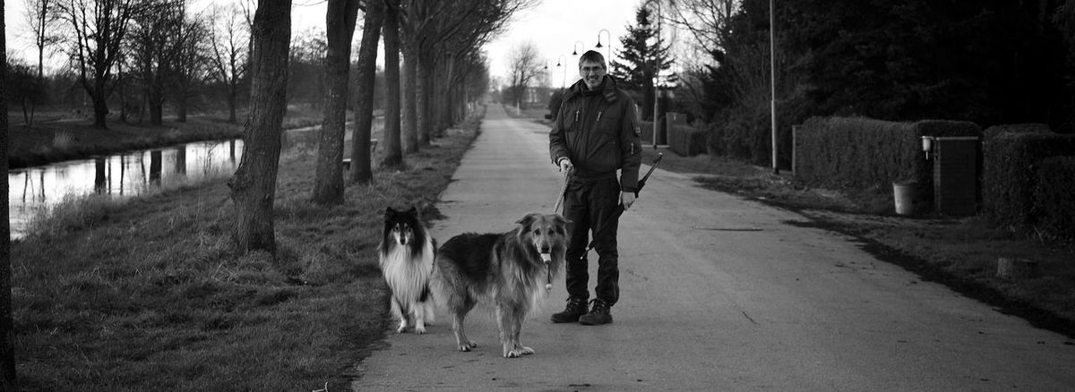 A friend with his dog's Dogs Nature On Your Doorstep Nikonphotography Hanging Out At The Street Taking Photos Nikon D5200 Litle River Trees Light And Shadow Blackandwhite B & W Photography People Photography