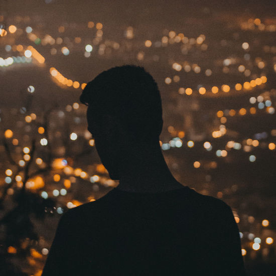 a friend portrait Artistic HUAWEI Photo Award: After Dark Rear View Art Bokeh City Focus On Foreground Headshot Illuminated Lifestyles Men Mood Night One Person Outdoors Photograph Portrait Real People Rear View Shadows Silhouette Standing