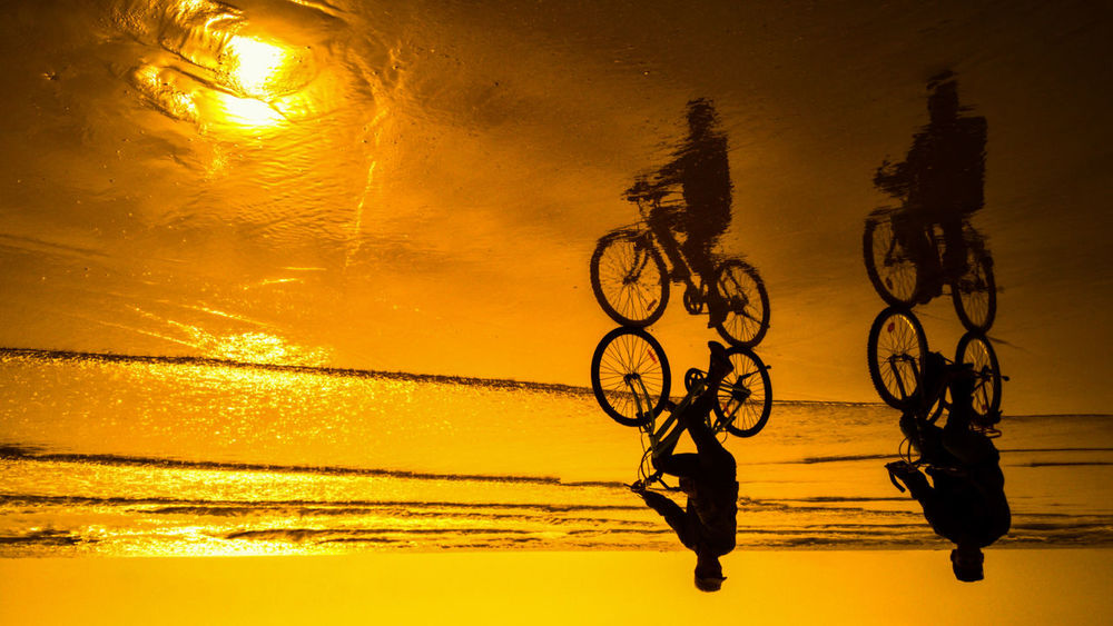 Live For The Story Bicycle Silhouette Sunset Water Sky Yellow Mobilephotography Lumia1020 Reflection Sunset Silhouettes Nature Day
