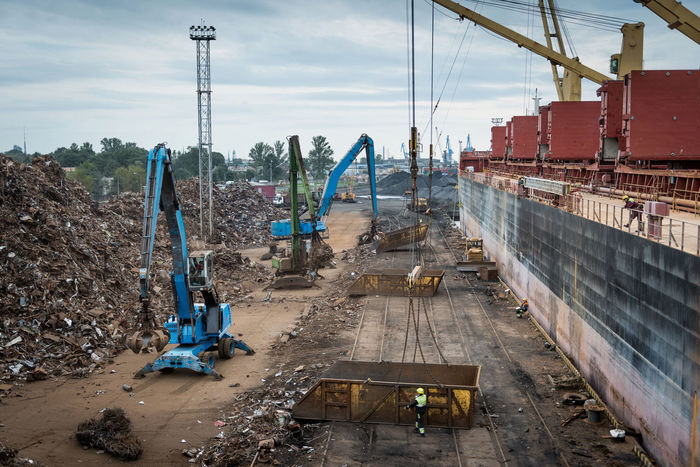Scrap metal transshipment port. Business Container Cranes Harbor Industry Relaxing Transport Boat Bulk Cargo Construction Machinery Construction Site Dock Equipment Export Import Load Logistic Metal Port Scenics Sea Ship Steel Terminal