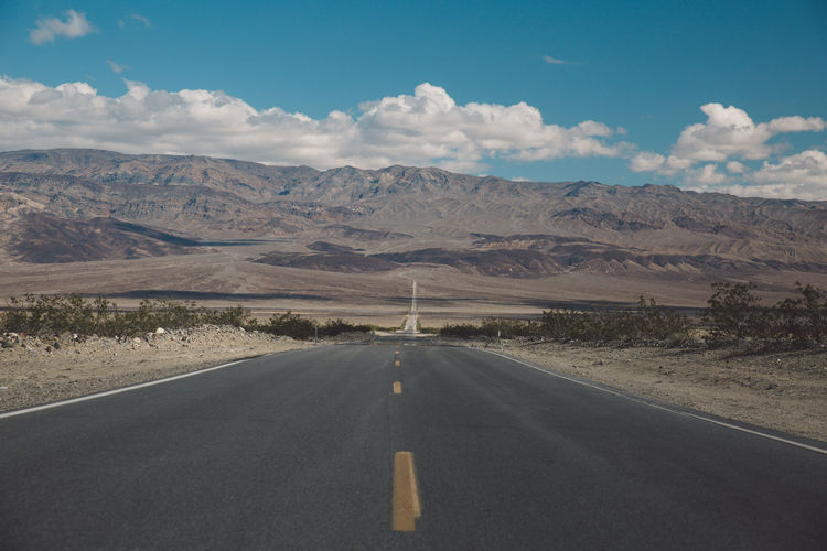 Arid Climate Arid Landscape California Cloud - Sky Day Death Valley Death Valley National Park Desert Landscape Mountain Mountain Range Mountains Nature Nature No People Non-urban Scene Remote Road Road Marking Roadtrip Scenics Sky The Way Forward Tranquil Scene Transportation
