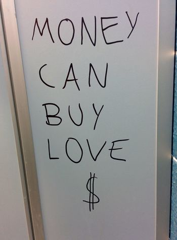 finally: money can buy love! Can't Buy Me Love Dollars Money Text The Message The Root Of All Evil Toilet Message Writing On The Walls