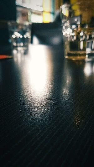 Table Indoors  No People Illuminated Close-up EyeEmNewHere EyeEm Selects Empty Table Night Bar - Drink Establishment Glass Objects  Glass Reflections The Week On EyeEm