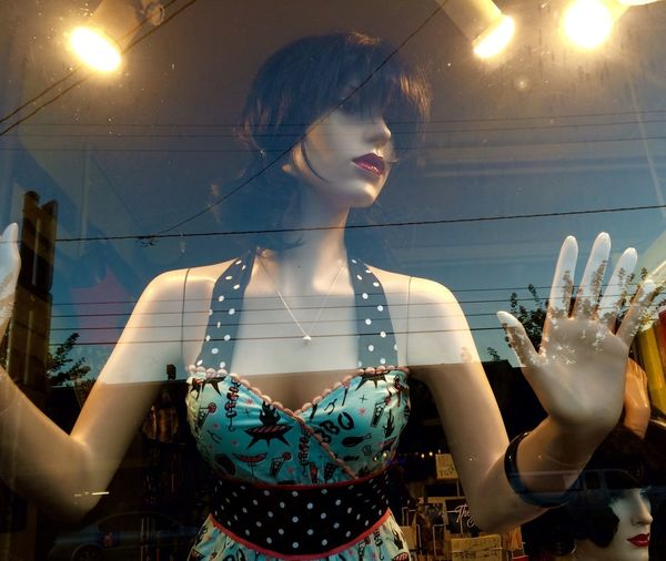 Mannequin At Fashion Shop Window