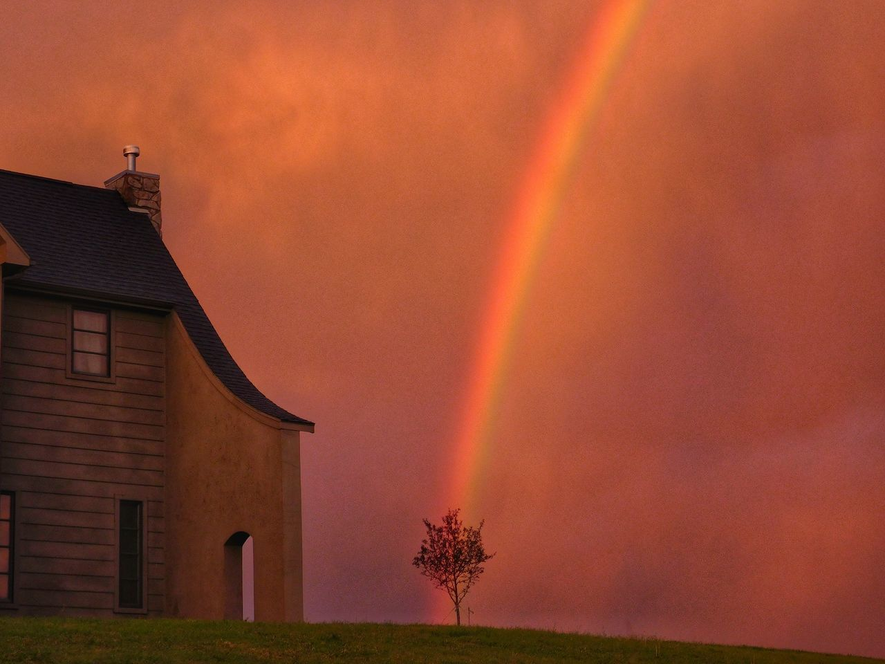 rainbow, beauty in nature, sunset, nature, no people, scenics, building exterior, built structure, tranquility, outdoors, tree, tranquil scene, architecture, sky, day