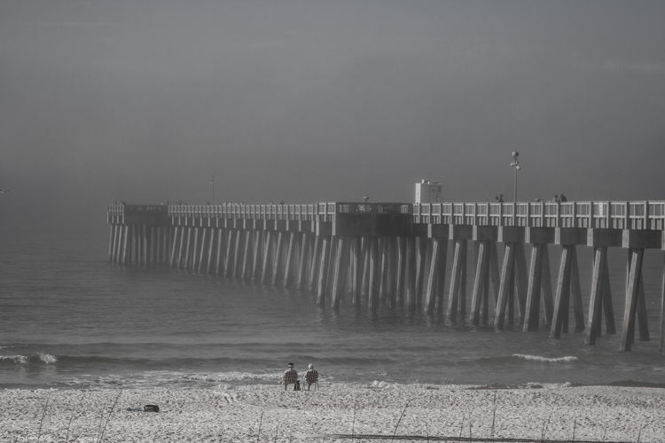 Clear Sky Dramatic Sky Pier Piercing Beach Beach Chairs Black And White Black And White Photography Concrete Pier Concrete Pillar Day Florida Fog Foggy Foggy Morning Ocean Outdoors Sand Sand And Sea Sand And Surf Sea Oats Sky