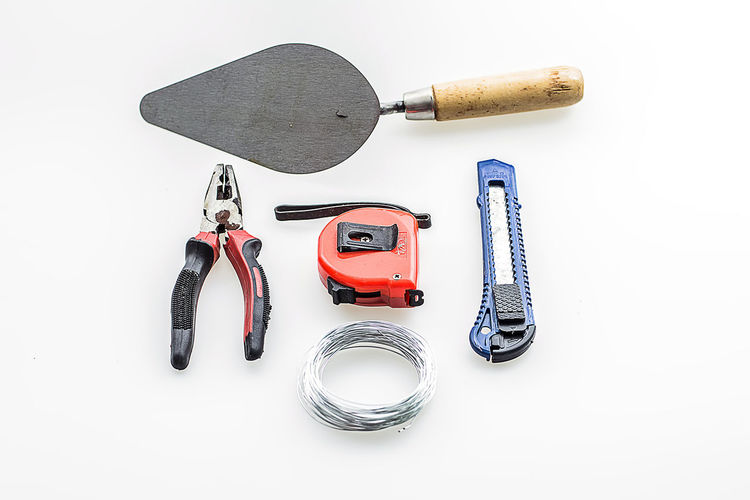 High angle view of work tools on white background