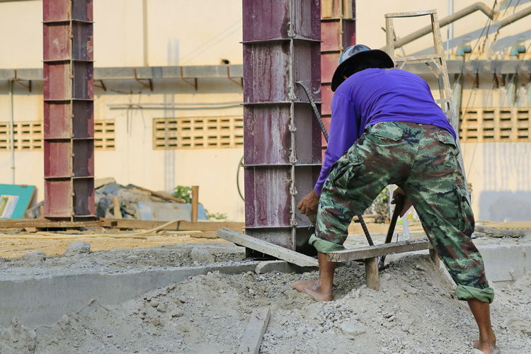 The construction technician is working on the casting of concrete pillars. Construction Construction Site Construction Industry Contractor Concrete Iron - Metal Pillar Pillars Craftsman Craftsman Working Industrial Building  Cement Form Builder Builder Worker Home Industry Post Career Basis Development Equipment Framework Architecture Building
