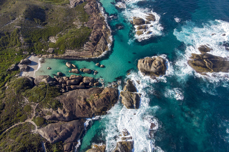 Aerial view of beautiful coastline Water Sea Rock Solid Rock - Object Motion Beauty In Nature Land Nature Scenics - Nature Beach Day No People Rock Formation High Angle View Outdoors Turquoise Colored Sport Coastline Rocky Coastline Eroded Aerial View
