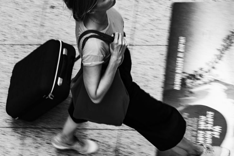 Street_21 Black And White Carrier Casual Clothing Close-up Day Focus On Foreground Hannover Hannover Central Station Leisure Activity Lifestyles Low Section Luggage Carrier Part Of Relaxation Sitting Tourist Travellar Woman