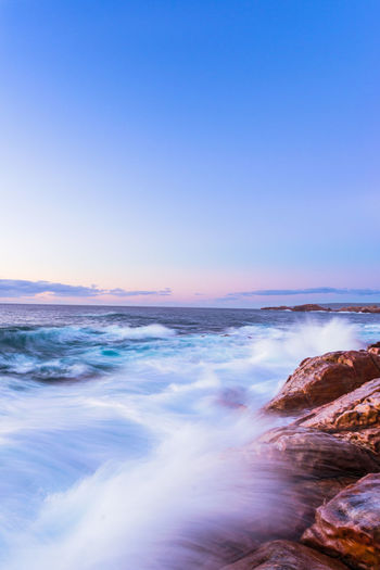 Rough sea at Injidup Bay Sea Water Sky Beauty In Nature Scenics - Nature Motion Beach Rock Wave Rock - Object Land Horizon Over Water Solid No People Nature Tranquility Blue Sunset Outdoors Power In Nature Australia Travel Destinations Travel Flow  Clouds Long Exposure