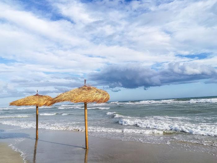 Beach Beachlife Sea Water Cloud - Sky Sky Beauty In Nature Scenics - Nature Horizon Over Water Horizon Nature Wave Tranquility Day Tranquil Scene No People Non-urban Scene Puglia Umbrellas On The Beach Umbrellas Summer