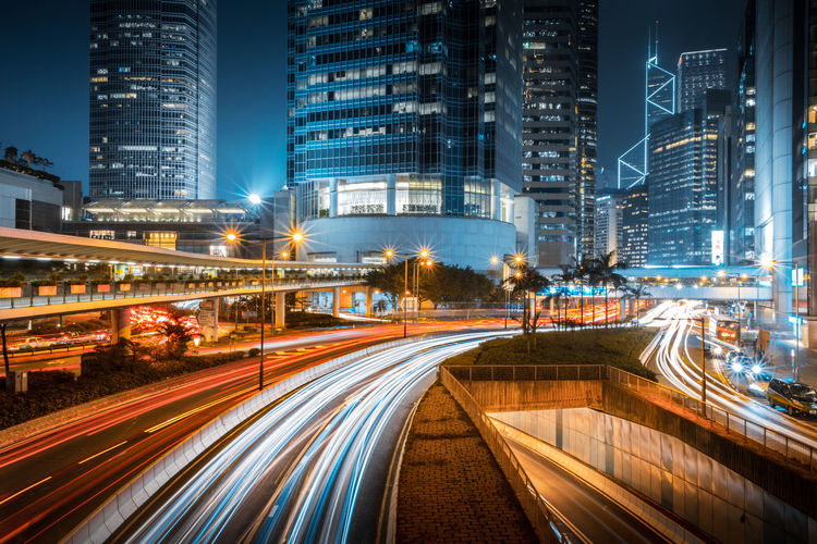 Architecture Blurred Motion Building Building Exterior Built Structure City City Life Cityscape Financial District  Illuminated Light Trail Long Exposure Modern Motion Night No People Office Building Exterior Outdoors Road Skyscraper Speed Street Traffic Transportation