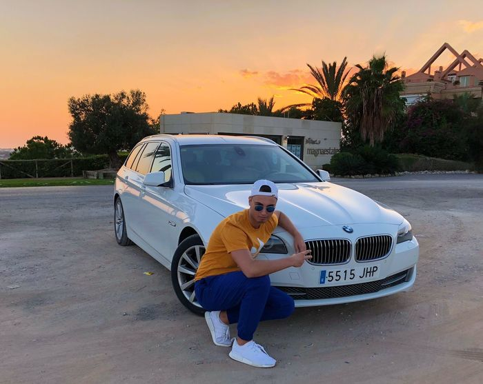 Car Transportation Sunset Mode Of Transport Full Length One Person Sunglasses Land Vehicle Real People Tree Casual Clothing Outdoors Sky Young Adult Sitting Day One Man Only Adult Adults Only People Adidas Bmw Connected By Travel Lost In The Landscape