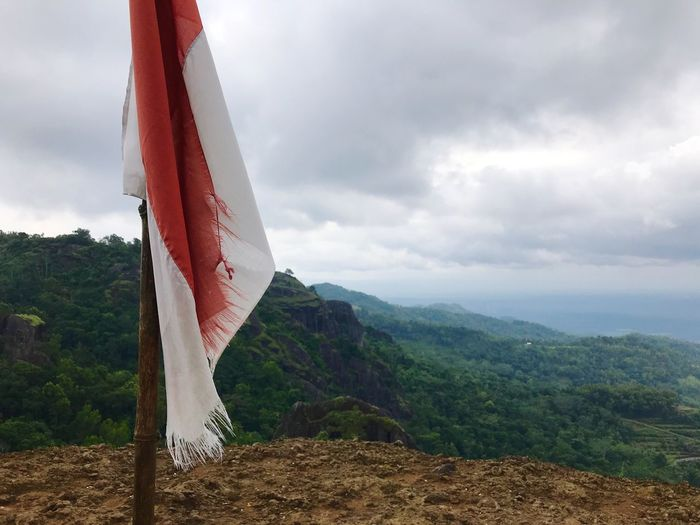 Indonesian Flag On The Top Indo Flag Flag Cloud - Sky Sky Beauty In Nature Scenics - Nature Landscape Mountain Nature Environment Tranquil Scene Tree Tranquility Plant Day No People Non-urban Scene Idyllic Land Outdoors Growth