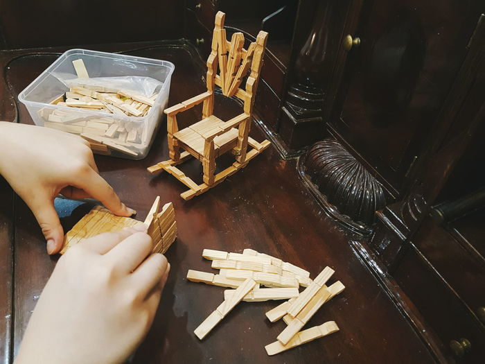 Art and craft projects Handicraft Art And Craft Art DIY Wooden Pegs Chair Miniatures Indoors  Human Hand High Angle View Table Human Body Part Wood - Material Arts Culture And Entertainment One Person People One Young Woman Only Close-up EyeEm Ready