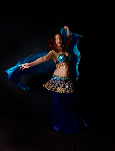 Belly Dance Belly Dancer Dance Beautiful Woman Belly Dancer Belly Dancing Bellydance Bellydancer Bellydancing Black Background Blue Celebration Color Dancer Dancing Front View Full Length Indoors  One Person Performance Posing Standing Studio Shot Young Adult Young Women