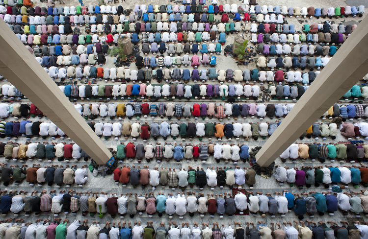 People are gathered to say their prayer at a Mosque named Jamiatul Falah in Chittagong, Bangladesh. Color Colorful Day Faith God God Is Great. Group Of People In A Row Islam Islamic Man Masque Multi Colored Namaz Organized People People And Places Photo Pias Shape Top View