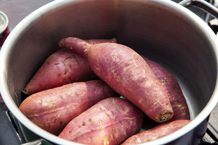 High angle view of sweet potatoes in container