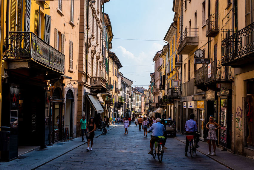 Pavia Italy City Bicycle Men Store Sky Architecture Building Exterior Built Structure Crossing Street Scene City Street Street