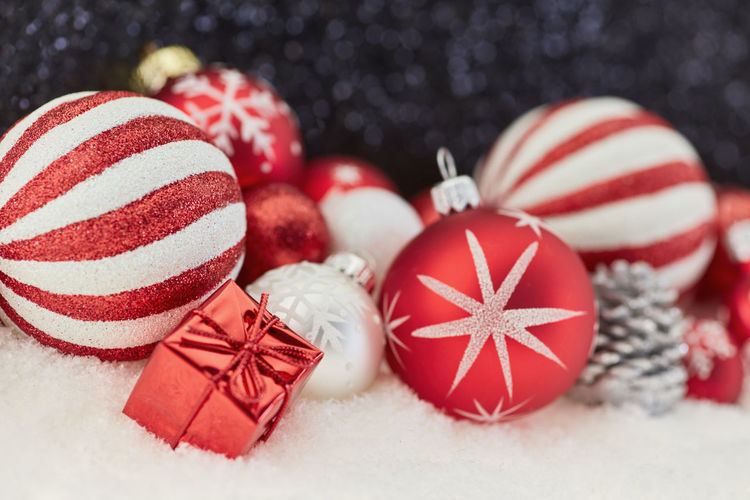 Close-Up Of Christmas Decorations On Fake Snow