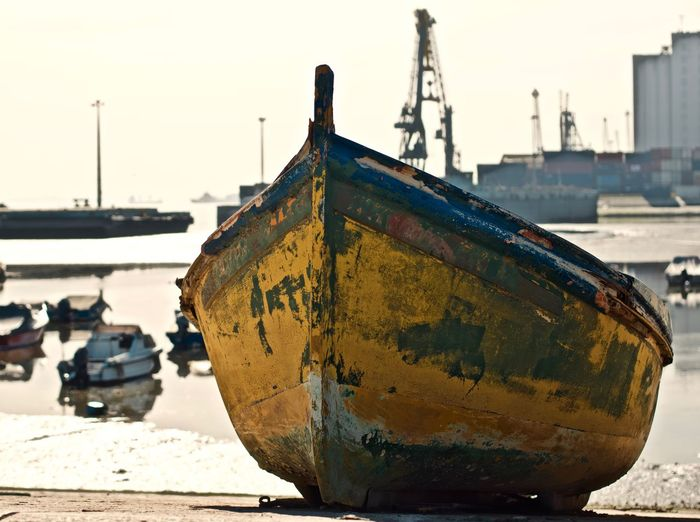 Transportation Mode Of Transportation Nautical Vessel Water Ship Sea Rusty Sky Moored Focus On Foreground Nature Day Clear Sky Abandoned No People Outdoors Beach Metal Land Deterioration Fishing Boat Sailboat Pollution