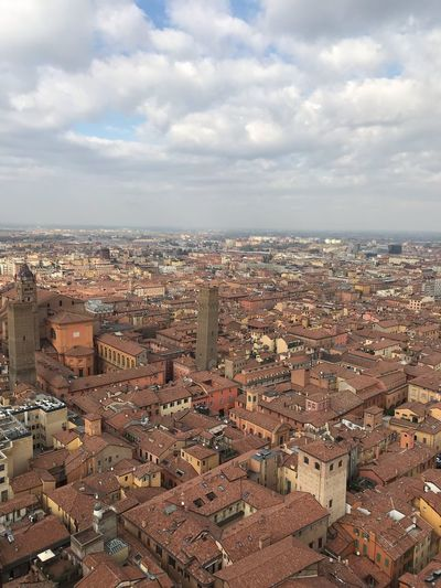 Bologna Bologna Roofs And Towers Roofs EyeEm Selects Building Exterior Architecture Cloud - Sky Cityscape City Built Structure Sky Building High Angle View Residential District Day Outdoors Aerial View City Life Community Horizon