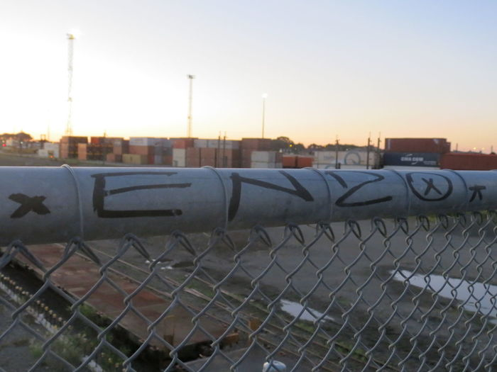 Protection Metal No People Outdoors Day Sky Calm Dusk Palmerston North Nz Tranquility Sunset Colours Orange Glow Peach Sky NZ Fresh Peace Streetart Railway Rail Train Tracks Railroad Transportation Sunset Graffiti Adapted To The City