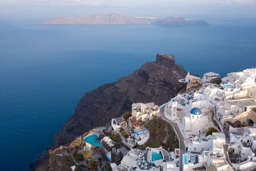 Santorini, Greece Water Sea Beauty In Nature High Angle View Architecture Nature Land Scenics - Nature Built Structure Beach Coastline Building Exterior Rock No People Mountain Rock - Object