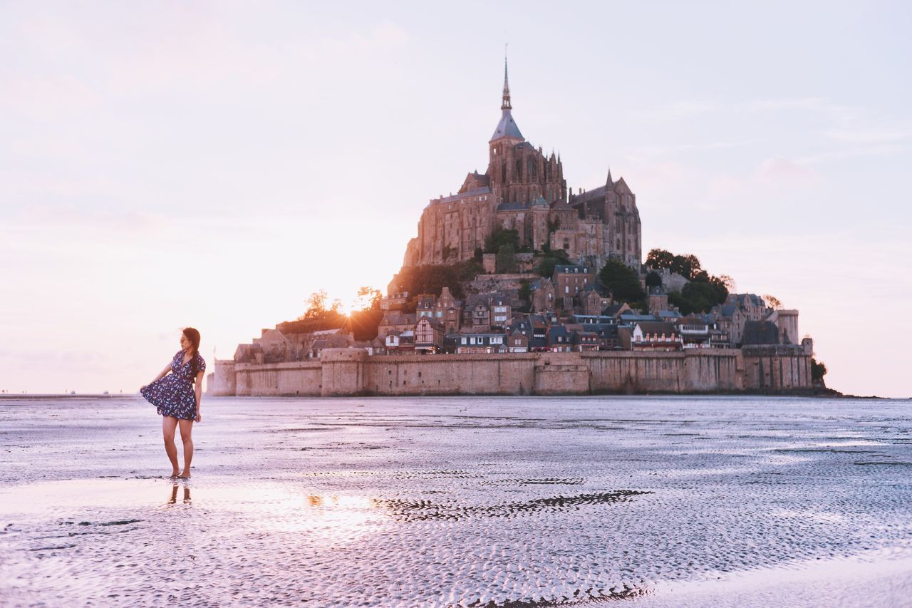 Woman standing in front mont saint michel island