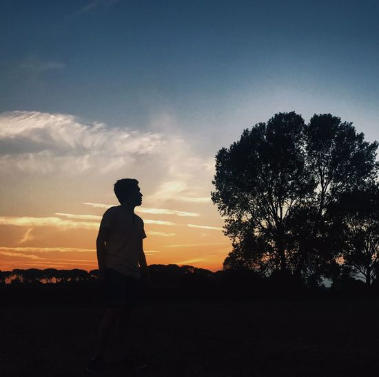 Sunset Silhouette People Nature Sky Adult One Person Adults Only Full Length Only Men Men One Man Only Beauty In Nature Young Adult Outdoors Tree Politics And Government Day Lost In The Landscape