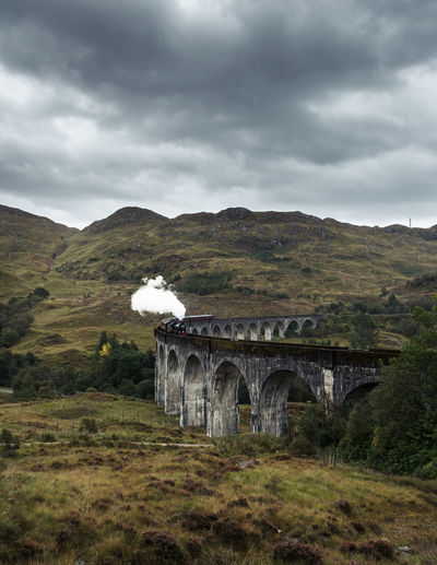 The Hogwarts Train in Scotland Harry Potter Harry Potter Train Hogwarts Hogwarts School Of Witchcraft And Wizardry Scotland Train Train Tracks Railway Railroad Track Railroad Viaduct Bridge - Man Made Structure Bridge Moody Moody Sky Landscape Landscape Photography Train Photography Smoke Mysterious Travel Destination Direction Choices Highlands