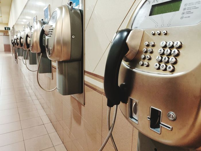 Close-up of telephones on wall