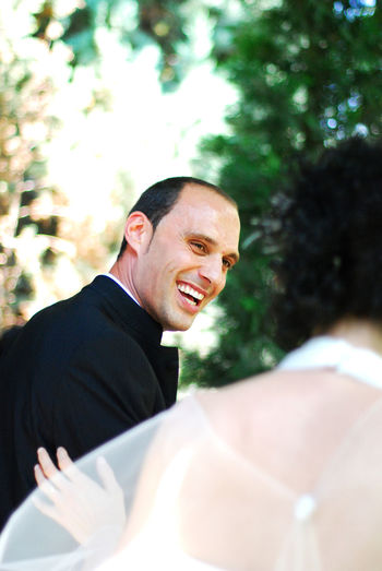 Close-Up Of Smiling Groom And Bride Outdoors