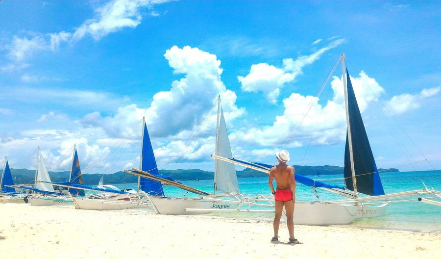 Sea Travel Cloud - Sky Beach Sky Travel Destinations Water Rear View Outdoors Vacations Adult Boracay Island, Philippines Boracay Sexyback Beachbum Beachphotography Paraw Parawsailing Tanning Summer Vibes Pinoy Traveldiary Sexymen Menofoutdoors Itsmorefuninthephilippines The Traveler - 2018 EyeEm Awards